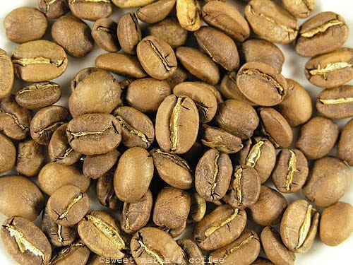 Middle of First Crack - 415 degrees F - Coffee bean macro image during roasting