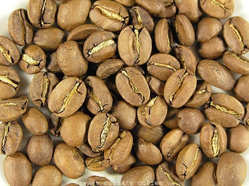 Ending of First Crack - 426 degrees F - Coffee bean macro image during roasting