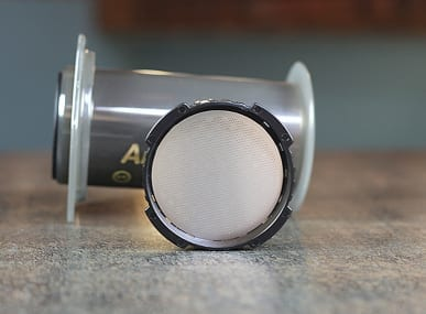 Aeropress coffee maker with stainless filter disc