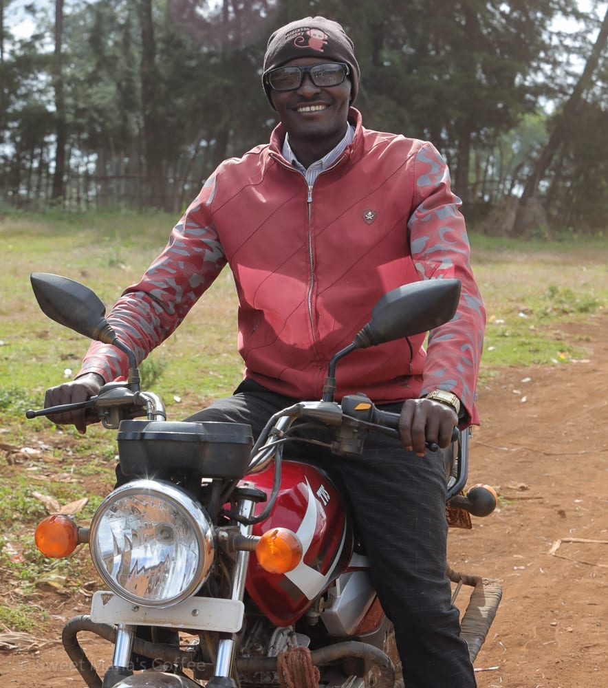 I don't even remember who he was, but he got a hat and he was happy. We were getting a bit turned around on the roads, and our guy Kedir sent him out to guide us on his motorcycle.