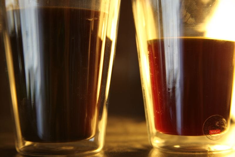 Showing the translucent cup of paper filter brew on the right and the opaque Swiss Gold brew on the left.