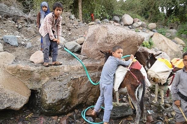 Transporting water in the Yemen coffee areas