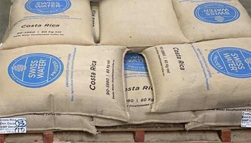 A pallet of Costa Rica coffee in GrainPro-lined jute bags that was decaffeinated by Swiss Water.