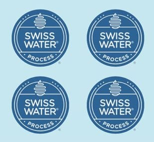 swiss water process decaf logo on blue background