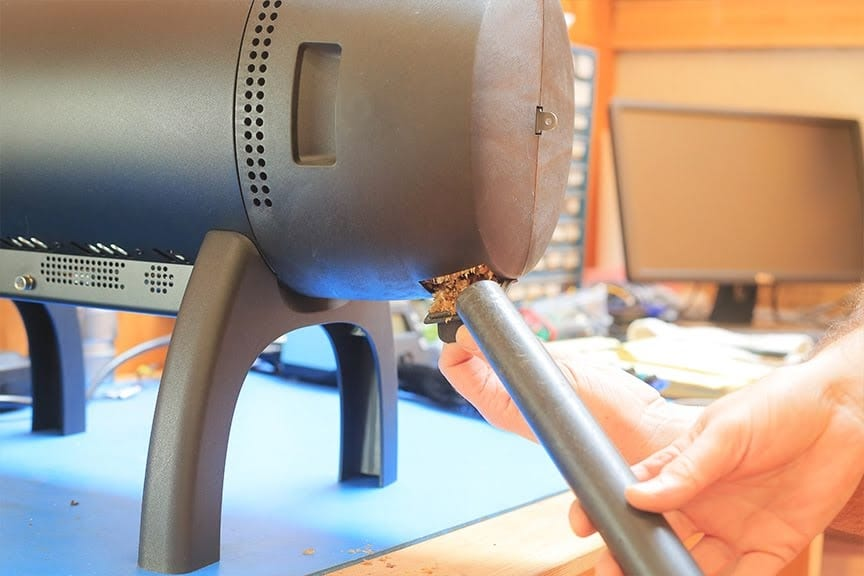 Vacuuming the chaff port chaff collector Aillio Bullet Coffee Roaster