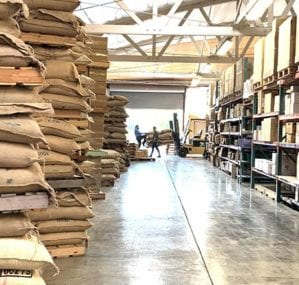 sweet maria's crew unloading the incoming green coffee on bean board pallets