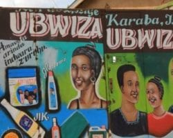 Hand-painted hair product signs in Burundi during a visit to green coffee sites